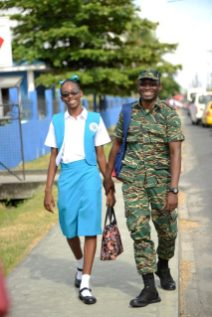 Second former Brittany Quamina and her father on their way to school this morning.