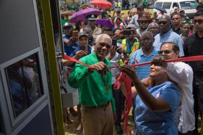 President David Granger and Prime Minister Moses Nagamootoo during the ceremonial cutting of the ribbon to commission the ambulance