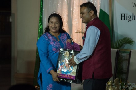 Minister of State, Hon. Dawn Hastings-Williams receiving a token from His Excellency Dr. K. J. Srinivasa.