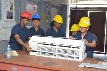 Some of the Air Conditioning and Repairs students attached to the Essequibo Technical Institute.
