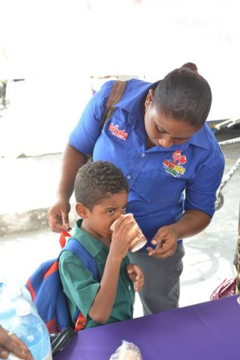 A primary school student takes his pill.