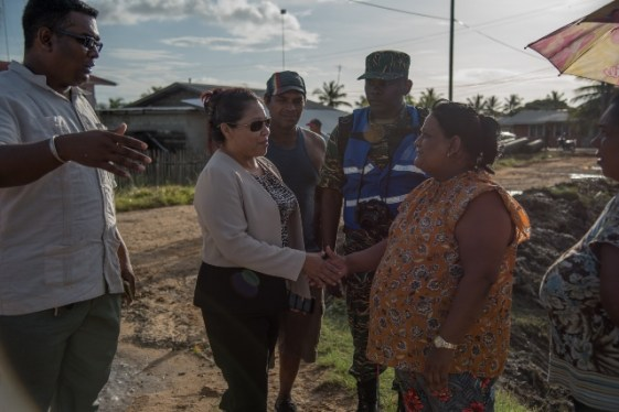 Minister of State, Hon. Dawn Hastings-Williams greets a resident of Zeelught, on Tuesday, during the distribution of hampers.