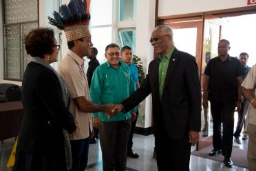 [In the photo, from left to right] Minister within the Ministry of Indigenous Peoples' Affairs, Hon. Valerie Garrido-Lowe, NTC Chairman, Toshao Nicolas Fredricks greeting His Excellency, President David Granger, Minister of Indigenous Peoples' Affairs, Hon. Sydney Allicock (background).