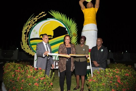 [In the photo, from left to right] Minister of Business, Hon. Haimraj Rajkumar with Debra Mattias cutting the ribbon along with Permanent Secretary attached to Ministry of Agriculture, Delma Nedd, Director-General at the Department of Tourism, Donald Sinclair.