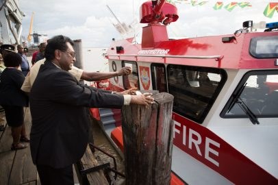 Minister of Public Security, Hon. Khemraj Ramjattan christening the fireboat.