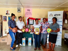 Angoy's Avenue Adolescents Youth Space members receive the equipment from Community Action Specialist Lauren Fraser (second from right).