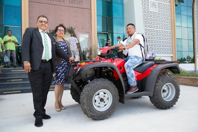 Minister of Indigenous Peoples' Affairs, Hon. Sydney Allicock and Minister within the Ministry of Indigenous Peoples' Affairs, Hon. Valerie Garrido-Lowe handing over the ATV to Toshao of Bashaizon Sidwell Johnson.