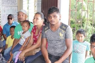 Residents of Arukamai listening to Minister of Communities, Hon. Ronald Bulkan attentively.
