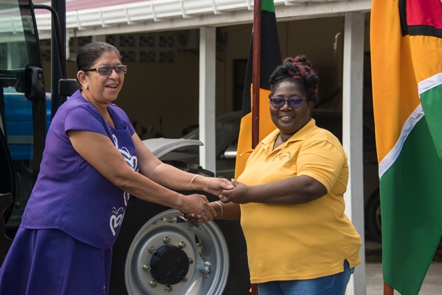 Regional Executive Officer (REO), Mitzy Campbell presents the keys to the tractor to Regional Education Officer (REDO), Penelope Mackintosh.