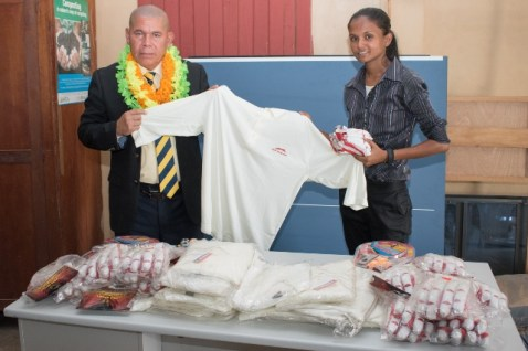 Minister of Social Cohesion, Hon. Dr. George Norton donating sport gear and equipment to Chairperson of the NDC, Keshni Rooplall.