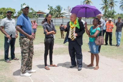 Minister of Social Cohesion, Hon. Dr. George Norton and his team visiting the Cane Grove community ground.