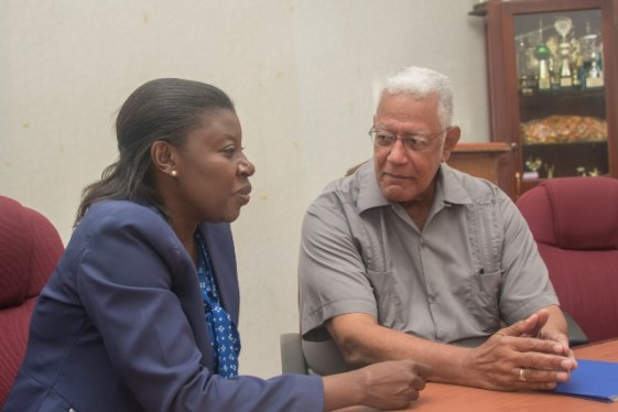 [In the photo, from left to right] Country Manager of WWF Guianas, Aiesha Williams interacts with Minister of Agriculture, Hon. Noel Holder.