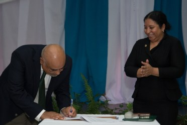 Professor Suresh Narine of Trent University and CGX signed the oil company's agreement today at the ELT.