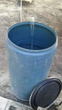 Improved water being stored in a drum by a resident.