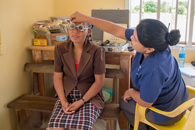 The Optometry intern, Carla Cassiano with a patient in the eye care section during the outreach.