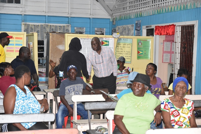 Minister of Citizenship, Hon. Winston Felix meets residents of Ithaca, West Bank of Berbice.