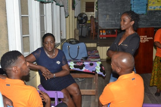 Minister of Education, Hon. Dr. Nicolette Henry [centre] and team engaging residents.