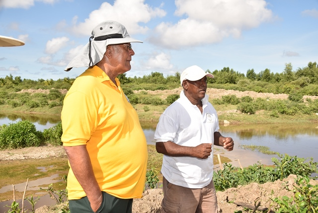 Minister of Agriculture, Hon. Noel Holder engages with a farmer about what is needed to bolster agriculture in the region further.