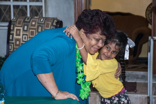 Little Sanjana Edmond greets Minister of Social Protection, Hon. Amna Ally.