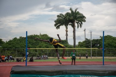 A competitor in action in the U20 high jump.
