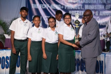 Anna Regina Secondary School (Proposition) receiving their prize from Chief Education Officer, Dr. Marcel Hutson.