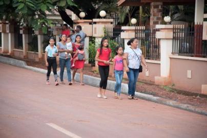 Residents walking along the Barrack Retreat Corridor road in Lethem