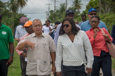 Minister of Foreign Affairs, Hon. Dr. Karen Cummings along with members of the Diplomatic Corp during a visit to flood affected communities in Region 5.