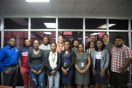 Senior Occupational Safety and Health Officer (left) Roydon Croal, General Manager of GYSBI, Sean Hill (center) Junior Occupational Safety and Health Officer Officer, Johana Vaughn (Second from right), along with participants of the Occupational Safety and Health training.