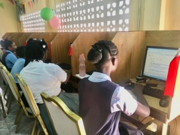 Students making use of the computers and internet access provided.