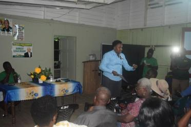 Minister within the Ministry of Communities, with responsibility for Housing, Hon. Annette Ferguson interacting with residents of Catherine and its environs during the community meeting.