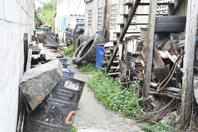 A section of the street blocked off by materials owned by the proprietor of the tyre shop
