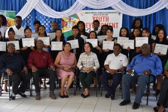 (Front Row from left) Programme Trainer Fitzroy Young, Mayor of Mahdia His Worship David Adams, REO Mitzy Campbell, First Lady Mrs. Sandra Granger, Regional Chairman Bonaventure Fredericks and Chairman of the Board of Industrial Training Clinton Williams, with graduates of the BIT, ICT programme