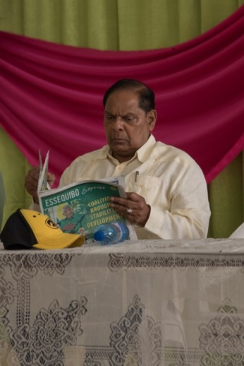 Hon. Prime Minister, Moses Nagamootoo, perusing the Essequibo Express, (produced by DPI), before addressing Guyanese on the Essequibo Coast on Sunday.