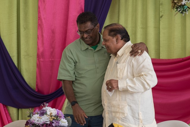 Hon. Prime Minister, Moses Nagamootoo shares a light moment with Minister of Public Security, Hon. Khemraj Ramjattan, during a community engagement in Essequibo on Sunday.