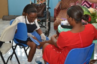 Student of the Open Doors Vocational Centre does a pedicure