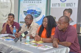 [L-R] Senior Transmission and Distribution Engineer (ag) Rovindranaugt Jagnanan; Customer Service personnel, Alicia Williams and employee within the Projects Department, Frank John