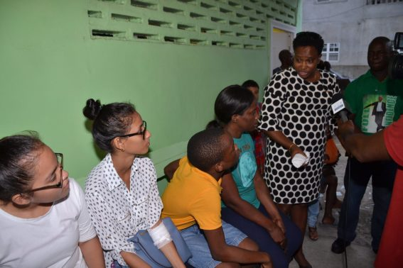 Minister within the Ministry of Communities with responsibility of Housing, Hon. Annette Ferguson speaking with some of the Bent Street fire victims
