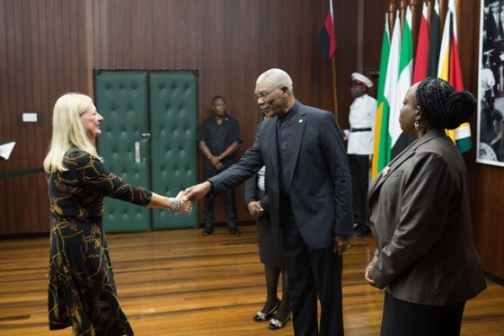 His Excellency President David Granger is greeted by the newly accredited Ambassador of Brazil to Guyana, Maria Clara Duclos Carisio.
