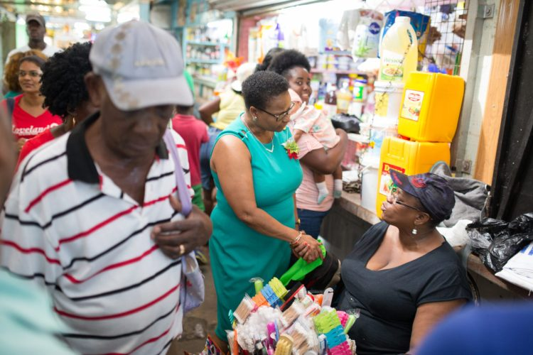 Government Ministers greet venders and shoppers Stabroek Square.