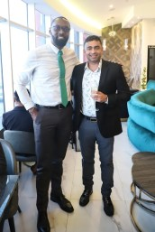 Director of Sports, Christopher Jones, with Owner of Bistro Wine & Champagne Bar, Ralph Persaud, at the official opening of the new MovieTowne location.