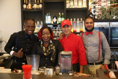 Staff members of Bistro Wine & Champagne Bar new MovieTowne location.