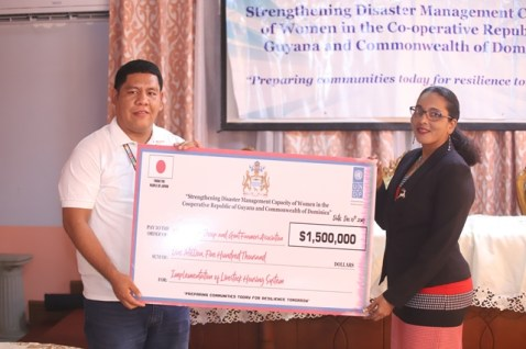 Jason Chacon, Project Manager, presents a cheque to Debora Gopaul