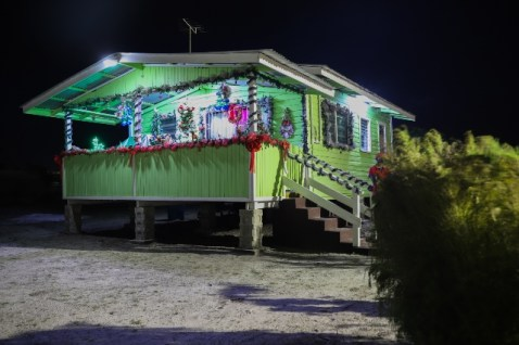 House in Prosville lit with electricity
