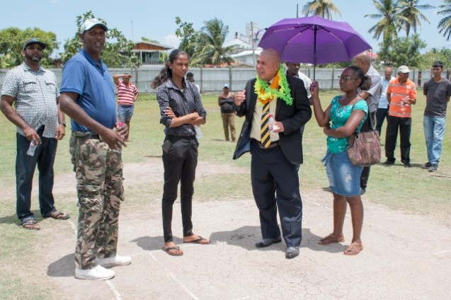 Minister of Social Cohesion Hon. Dr. George Norton and his team visiting the Cane Grove Community Ground, earlier this year.