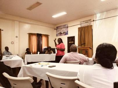 A Health Education Officer engages a section of the gathering.