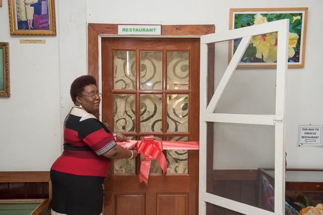 Myrna Lee, Principal, Carnegie School of Home Economics cuts the ribbon at the opening ceremony.