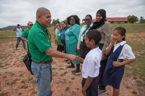 : Minister of Social Cohesion, Dr the Honourable George Norton greeting residents.