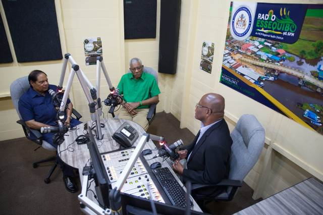 In the studio: His Excellency, President David Granger (centre) and Prime Minister, Hon Moses Nagamootoo (left) chat with Chairman of National Communications Network Enrico Woolford on the first live broadcast on Radio Essequibo 95.5 FM.
