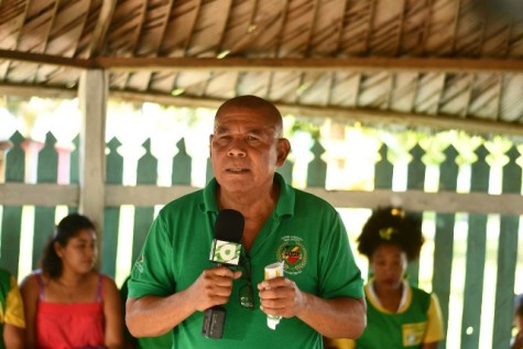 Minister of Social Cohesion Hon. Dr. George Norton addressing residents of Lake Capoey, Region 2.