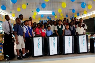 Minister Henry and Ambassador Dormeus along with head teachers and students of the 14 schools pose for a photograph with the Profuturo Kits.